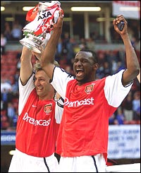 Tony Adams and Patrick Vieira hold the FA Cup trophy after defeating Chelsea 2-0