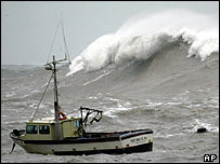 Fishing boat and huge wave   AP