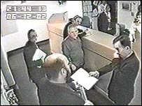 Imiela (centre) just prior to being charged with the rapes