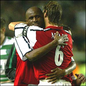 Vieira hugs Tony Adams at his testimonial against Celtic