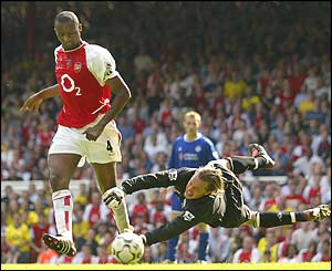 Vieira slides the ball past Ian Walker in Arsenal's 2-1 win over Leicester