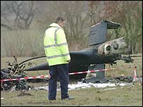 An investigator at the crash site just east of Bournemouth airport