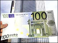 A euro note held in front of the European Central Bank in Frankfurt, Germany