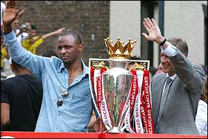 Patrick Vieira and manager Arsene Wenger take pride of place on the open-topped bus