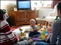 Family in living room, BBC