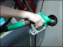 A man puts petrol in car