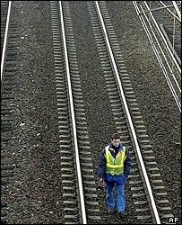 A railway worker checks the track