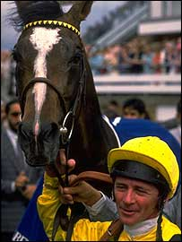 Jockey Michael Roberts with Mtoto after winning King George VI and Queen Elizabeth Diamond Stakes at Ascot  in 1988