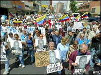 Chavez opponents march to demand the release of people they say were arrested during the recent unrest