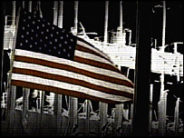 Image of US flag in front of WTC remains from Bush campaign ad