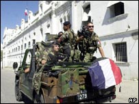 Soldiers of the French Antilles Army patrol the streets of Port-au-Prince
