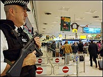 An armed police officer stands guard at Heathrow