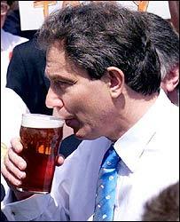 Tony Blair sups an ale