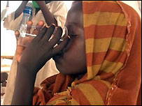 Girl taking cholera medicine in Kalma IDP camp in Darfur, Sudan