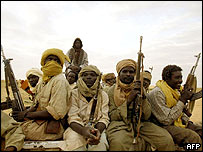 Rebels of the Movement for Justice and Equality (MJE), fighting Sudanese troops, patrol 28 July 2004 in north Darfur
