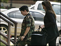 Pte Lynndie England and one of her lawyers arrive for the third day of the hearing