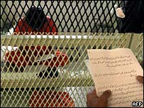 A Guantanamo detainee hearing the notice of his right to appeal his status