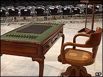 A chair, antique desk and pens at the abandoned Iraqi constitution signing ceremony