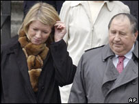 Martha Stewart leaves court with her lawyer Robert Morvillo