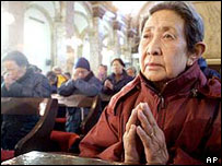 A Chinese woman in a Catholic cathedral in Beijing (archive picture)