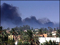 Smoke rises over Najaf