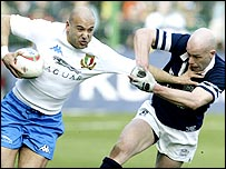 Denis Dallan tries to hand off Scotland's Simon Webster