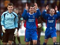 Delighted Caley Thistle players celebrate at full time