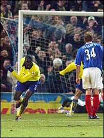 Arsenal's Kolo Toure scores Arsenal's third goal in the win over Portsmouth