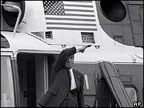 Richard Nixon waves farewell as he boards a helicopter after resigning on 9 August 1974