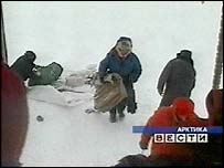 The scientists are about to board the rescue helicopter. Picture: Russian RTR television