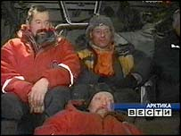 The rescued scientists aboard the helicopter. Picture: Russian RTR television