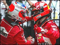 Rubens Barrichello and Michael Schumacher embrace after the race