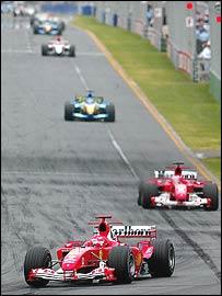 Michael Schumacher leads Rubens Barrichello, Fernando Alonso, Jenson Button, Jarno Trulli and the rest in the early laps in Melbourne