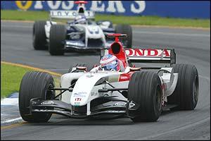 Jenson Button's BAR fends off Juan Pablo Montoya's Williams