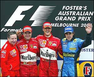 Ferrari sporting director Jean Todt, Rubens Barrichello, Michael Schumacher and Fernando Alonso on the podium
