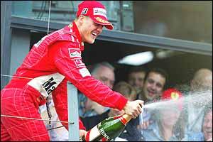 Michael Schumacher sprays champagne on the rostrum