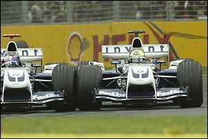 Juan Pablo Montoya overtakes Ralf Schumacher early in the Australian Grand Prix