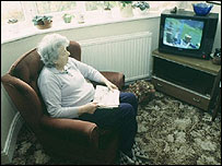 Pensioner watching television (generic)