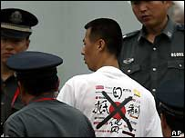 Chinese man wears shirt calling for boycott of Japanese goods