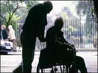 Old men, one in wheelchair