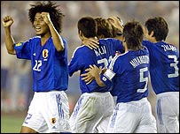 Japanese players celebrate after Takashi Fukunishi scores Japan's first goal