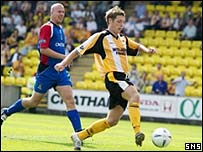 Burton O'Brien taps in the opening goal for Livingston