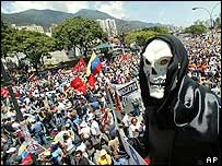 An anti-President Hugo Chavez protester dressed as death rallies with other opponents of Chavez in Caracas on 6 March