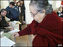 A woman votes in the Greek elections