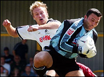 Swansea's Paul Connor challenges goalkeeper Lee Harper