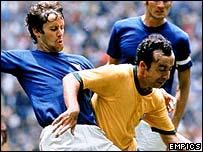 Italy's Roberto Rosato challenges Brazil's Tostao