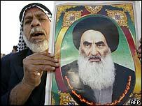 Iraqi holds picture of Shia cleric Ayatollah Sistani
