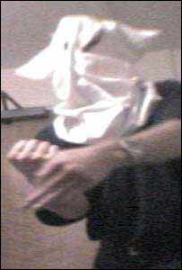 A still from the documentary showing Rob Pulling in a Ku Klux Klan hood
