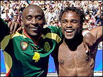 Serge Mimpo and Patrick K Suffo of Cameroon celebrate gold