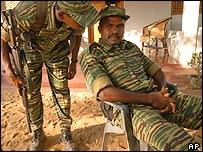 Colonel Karuna confers with a guard